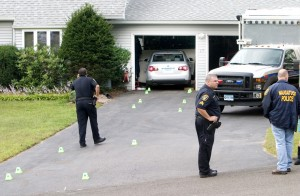 Police found Julie Swoszowski's car smashed into the garage of her ex-boyfriend's home at 65 Village Circle, where they also discovered the 31-year-old woman bleeding from stab wounds. Swoszowski died from her injuries. The Office of the Chief Medical examiner confirmed Friday that her death was a suicide.