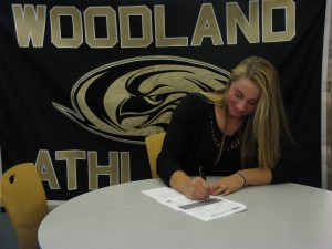 Woodland senior Katie Alfiere signed a national letter of intent to play softball at Quinnipiac University last Friday at Woodland.