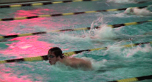 Naugatuck's T.J. Warren takes a breath on his way to winning the 100-yard butterfly in 1:03.59.