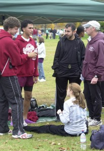 """Hanley (far right), pictured at the 2008 New England cross country championships with, from left, assistant coach Matt Basile, Hrezi, Hrezi's father, Fuad, and Moriello (seated), calls his top runners """"students of the sport."""""""