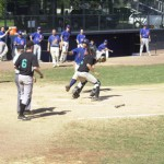 Housatonic Valley catcher Dan McCue attempts to block the plate as Eastern Massachusetts baserunner Chris McCarthy slides in safely.