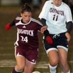 Naugatuck's Nicole Sambrook keeps the ball away from Torrington's Morgan Thulin in Monday's NVL semifinal at Municipal Stadium. The Hounds won, 3-0.