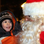 Danny Anderson, 4, chats with Santa during the seventh annual Holiday Kickoff held Dec. 6 on the Naugatuck Green.
