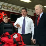 Captain Dave Rybinski, left, looks on as Public Information Officer Jeremy Rodorigo, middle, shows Sen. Joe Lieberman the fire company's equipment.