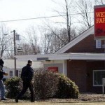 Police secure the area out the Wells Fargo Bank at 66 Waterbury Road in Prospect on Saturday after the bank was robbed by two armed men. -QUANNAH LEONARD
