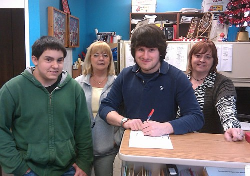 Naugatuck Student Government Day was held May 17. Twenty-two Naugatuck High School students participated in the annual event, learning from Town Hall officials and department heads about the roles they play in town government.  Pictured above, Naugatuck High School students Chris Gombos, left, and Thomas O'Connell visit with Registrar of Voters, Louise Sheedy and Janice Dambowski during Student Government Day. O'Connell, who turns 18 before the next election, took the opportunity to register to vote. -CONTRIBUTED
