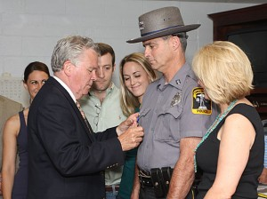 Prospect Mayor Robert Chatfield, left, pins a medal on Prospect Police Officer Douglas Fairchild for his heroic actions during a March 26 bank robbery at Wells Fargo Bank in Prospect. Chatfield honored three officers during a ceremony at Town Hall June 7.