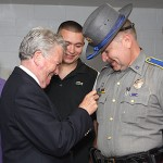 Prospect Mayor Robert Chatfield, left, pins a medal on Prospect Police Officer Nelson Abarzua for his heroic actions during a March 26 bank robbery at Wells Fargo Bank in Prospect. Chatfield honored three officers during a ceremony at Town Hall June 7.