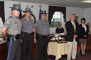Prospect Mayor Robert Chatfield, right, honors Prospect Police officers, from left, Nelson Abarzua, Douglas Fairchild, and Andy Giordino for their role in capturing two bank robbers following a March 26 robbery of Wells Fargo Bank in Prospect.