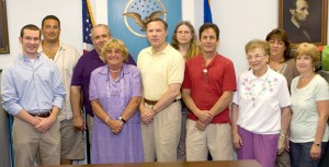 From left, Democratic candidates Erik Dey, Lou DiPiro, Art Daigle, Susan Cable, Chris Bielik, Carolyn McMahon, William Giglio, Millie Jurzynski, Wendy Oliveira, and Arlene Brumer pose for a group photo following the Democratic Caucus Tuesday.