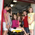 Children from the United Day School summer camp pack into the back of an ambulance Friday morning at Beacon Hose Co. 1. The children donated $530 to the company. LARAINE WESCHLER