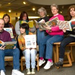 Whittemore Library staff, from left, John Wiehn, Rosalie Cummings, Pam Bogert, Marissa Ciullo, Diana Scalzi, Jocelyn Miller, and Gina Owens sport jeans last Friday to raise money for books.