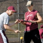 Naugatuck High School baseball coach Tom Deller gives senior Zac Mercer, 18, some pointers at the high school March 19. The Greyhounds open their season April 4 at Wolcott. RA ARCHIVE