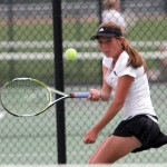 Naugatuck's Miranda Jang returns the ball during NVL girl's tennis semifinals at Woodland High School in Beacon Falls last Saturday afternoon. On Tuesday, Jang gave Naugatuck their only match win in a loss to Simsbury in the opening round of the Class L tournament. Jang will now play in the State Open tennis tournament beginning Saturday at Yale. –RA ARCHIVE