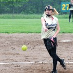 Woodland's Stephanie Kiley pitches in the rain against Ansonia during the NVL quarterfinals Monday at Woodland Regional High School in Beacon Falls. The game was suspended after the fourth inning, with the Hawks up 12-6, and postponed again on Tuesday due to rain. The game was scheduled to resume today. –LUKE MARSHALL