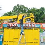 Bob Kifer of Marenna Amusements stands next to the Expo Wheel Tuesday morning as the crew sets up for the St. Francis-St. Hedwig School Carnival on the St. Francis Field in Naugatuck. The carnival opens Thursday night and runs through Tuesday. –LUKE MARSHALL