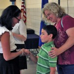 Algonquin School Principal Rima McGeehan (left) introduces herself to Benjamin Pucci, 8, and his mother Sue Pucci during a reception Monday night at the school in Prospect. McGeehan will officially start her job as principal Wednesday. –ELIO GUGLIOTTI
