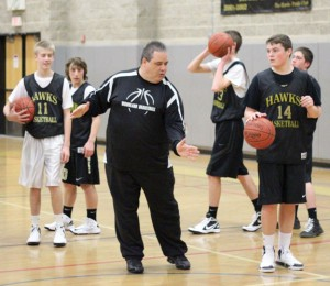 Woodland boys basketball coach Tom Hunt and his team earned an emotional win with an upset of No. 2 Wilby Jan. 25. The game was the night after the funeral of George Pinho, father of junior Jack Pinho and assistant football coach at the school. –FILE PHOTO