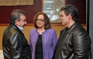 Newly-elected Naugatuck Portuguese Club President Mariana Branco-Barnes, center, talks with Vice President Alberto Janeiro, right, and club member Carlos Ramos, left, Sunday morning at the club on Rubber Avenue.  Mariana Branco-Barnes is the club's first woman president. –ELIO GUGLIOTTI