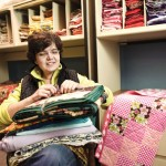 Mirya Catanzaro of New Britain is the vice president of Quilts That Care. She sits inside the new Naugatuck warehouse space donated to the organization, which supports cancer patients by giving them homemade quilts. -RA ARCHIVE