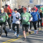 Racers run down North Main Street in Naugatuck during the 2nd Annual St. Patrick's Day 5K Running Race & Fun Walk last March.-CONTRIBUTED