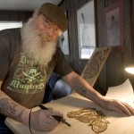 John MacDonald of Naugatuck does some wood burning at his home in Naugatuck Wednesday. MacDonald is the grand marshal at the St. Patrick's Day parade in Waterbury on Saturday.  –RA ARCHIVE