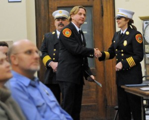 Naugatuck Fire Chief Ken Hanks, left, and Deputy Fire Chief Ellen Murray recognize firefighter Tim Andrews as a past recipient of the Naugatuck Exchange Club's firefighter of the year award during the Naugatuck Fire Department's recognition ceremony Jan. 30. -LUKE MARSHALL