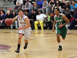 Naugatuck's Jason Bradley (11) brings the ball up court as Wilby's Ryan Spears (12) defends Monday night in Naugatuck. Naugatuck upset Wilby, 80-72. –ELIO GUGLIOTTI