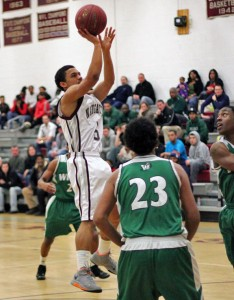 Naugatuck's Mick Pernell puts up a shot Monday night at home versus Wilby. Pernell scored 21 points as the Greyhounds upset the Wildcats, 80-72.
