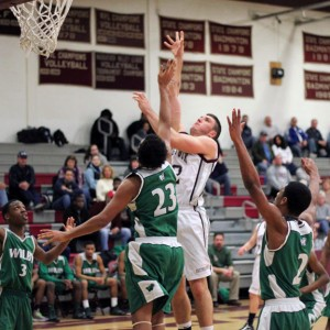 Naugatuck's Brandon Kuczenski (42) shoots over Wilby's Eric DeJesus (23) Monday night in Naugatuck. Kuczenski scored a team-high 33 points as Naugatuck upset Wilby, 80-72. –ELIO GUGLIOTTI