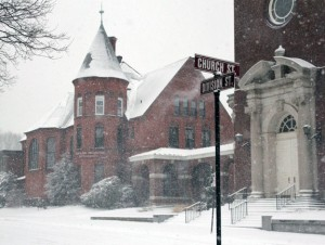 Snow falls in downtown Naugatuck on Friday afternoon. Schools have been closed since Friday in Naugatuck and Region 16 and will be closed again Tuesday. –ELIO GUGLIOTTI