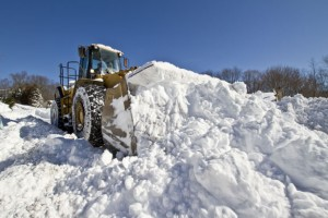 Jim Warren of Capitol Quarry Materials in Naugatuck plows Morning Dove Road Sunday morning with a payloader. Regular plow trucks could not handle the massive amounts of snow that hit Connecticut Friday and Saturday. –RA ARCHIVE