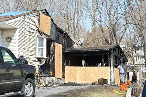 A fire destroyed the garage and damaged the kitchen and attic of this house on Pearl Street in Naugatuck on Saturday night. –RA ARCHIVE