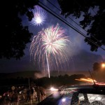 Residents line Millville Avenue in Naugatuck last Fourth of July to watch the annual fireworks show held at Naugatuck High School. This year's show will be held on Rotary Field on Hotchkiss Street due to renovations planned for the high school. –RA ARCHIVE