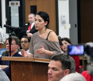 Heidi Crowley questions Gov. Dannel Malloy about his proposal to limit the capacity for gun magazines to 10 rounds during a community forum Wednesday night at Naugatuck High School. –ELIO GUGLIOTTI