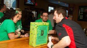 Jesse Camilles bartender Willie Levesque waits on Sofia Ricciardi-Swaby, Stefanie Zottola and Danny Suarez who were at the bar as part of a pub crawl group raising money for the Dawn Lafferty Hochsprung Memorial Fund Saturday afternoon. –RA ARCHIVE