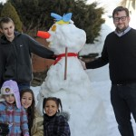 Children put all the snow from the blizzard in February to good use Feb. 15 as they built a snowman in front of the Whittemore Library in Naugatuck. Posing with the snowman is, bottom row from left, Jazlyn Ramos, Janay Ramos and Sara Decicco, standing from left, library volunteer Chris Soldberg and Children's Librarian Matthew Yanarella. –LUKE MARSHALL