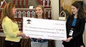 Naugatuck Education Foundation Director Eileen Lauer, left, presents a grant to City Hill Middle School teachers Shelby Adams, center, and Meaghan Ames April 11 during a grant reception at the Naugatuck Historical Society Museum. –ELIO GUGLIOTTI