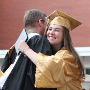 Woodland Regional High School graduate Kasey Smith hugs her advisor Thomas Straub after receiving her diploma Monday night during graduation at the school in Beacon Falls. –ELIO GUGLIOTTI