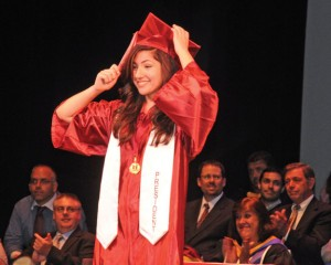 Naugatuck High School Class of 2013 president Melina Dezhbod leads the graduates in the turning of their tassels Monday night at the Palace Theater in Waterbury. LUKE MARSHALL