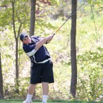 Woodland sophomore Mike Erickson became the first golfer in the school's history to qualify for the Division III state tournament on his own this season. –FILE PHOTO