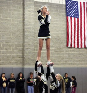 Woodland Regional High School cheerleaders perform a routine during a pep rally in November. The Board of Education has reinstated the assistant coach position for the squad after it was cut from the budget in June. –FILE PHOTO