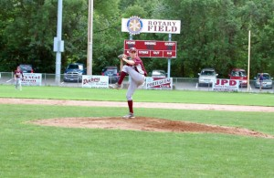 Post 17's John Dean delivers a pitch against Monroe Tuesday at Rotary Field in Naugatuck. Dean pitched a complete game and shutout Monroe as Post 17 won, 4-0. –KEN MORSE