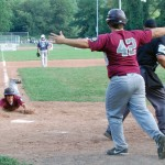 Naugatuck's Jason Bradley slides across home plate to give American Legion Post 17's junior squad a dramatic 5-4 win over Stamford as teammate Kevin Mariano (42) runs in to celebrate Monday afternoon at Rotary Field in Naugatuck in the opening game of the state tournament. –KEN MORSE