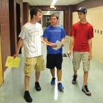 Woodland Regional High School rising senior Jeffrey Lauck, left, leads incoming freshmen Christopher Lauck and Matt Hicks on a tour of the high school during Aug. 27. –LUKE MARSHALL