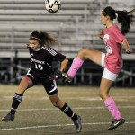 Naugatuck High's Taylor Campos, left, and Holy Cross' Tess Carella battle for control of the ball last fall. Campos, the Greyhounds' center midfielder, has been chosen to play on a U-17 Olympic development team.  –RA ARCHIVE
