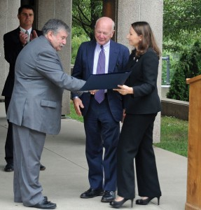 John Rodrigues, left, receives a citation from state Sen. Joseph Crisco (D-17) and state Rep. Rosa Rebimbas (R-70) as Mayor Robert Mezzo applauds Aug. 30 during a ceremony honoring Rodrigues as Naugatuck's Portuguese Mayor of the Day in front of Town Hall. –LUKE MARSHALL