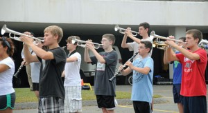 Members of the Naugatuck High School marching band practice Sept. 12 at City Hill Middle School. The marching band is hosting the annual Thunder in the Valley competition Saturday at 7 p.m. at the high school. The competition will be the first for the band on the new turf field. –LUKE MARSHALL