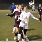 Naugatuck's Kyla Magalhaes (19) and Watertown's Erin Montambault (4) battle for position Wednesday night during the NVL soccer final game at Municipal Stadium in Waterbury. –ELIO GUGLIOTTI
