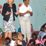 "Salem Elementary School Principal Jennifer Kruge, left, and Special Olympic medalist Loretta Claiborne address students at the school in Naugatuck on Oct. 9. Claiborne visited Salem and Naugatuck High School to talk with students as part of the high school DECA group's ""Spread the Word to Stop the Word"" campaign. -LUKE MARSHALL"